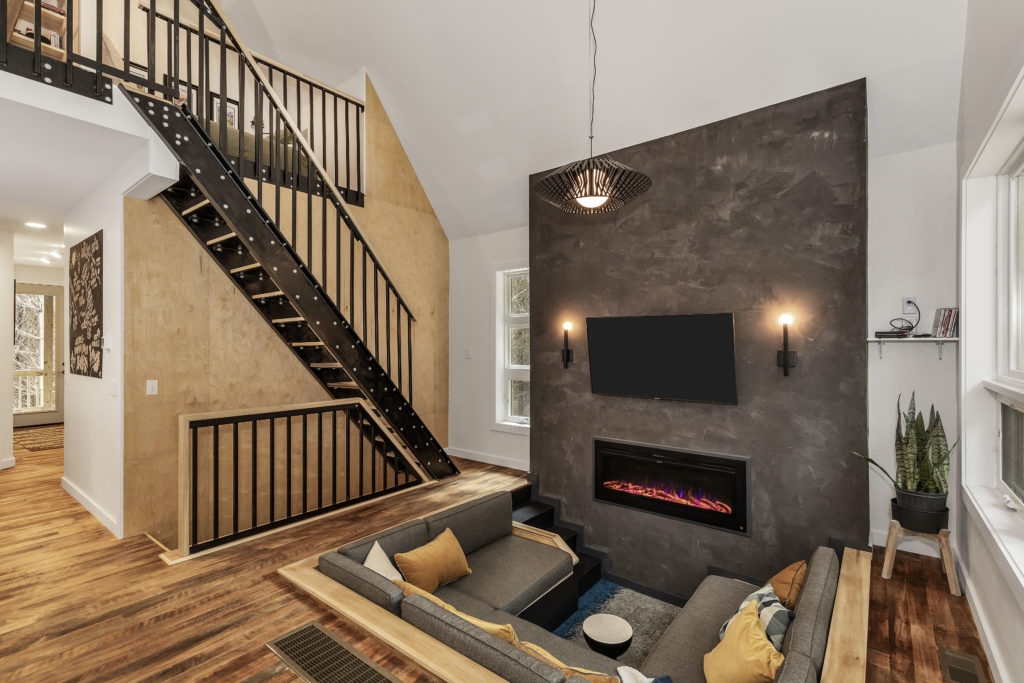 carpenters cabin conversation pit fireplace stair wall